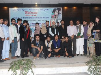 Group photo with Iqra University staff